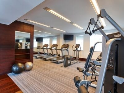 Photo of exercise equipment in a hotel gym.