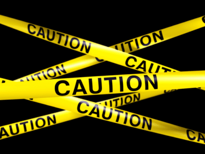Photo of yellow caution tape.