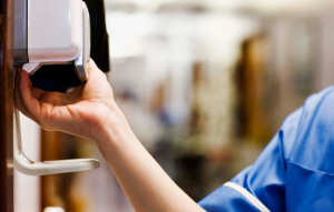 Purchase hand sanitizer dispensers to mount on walls in high-traffic areas or entryways.